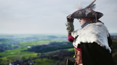 Female Adventurer looking down at landscape - stock footage