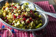 pomegranite brussel spout salad with walnuts - stock photo