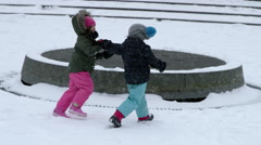 Children running around circle NYC blizzard 4k slow motion snowing NYC Stock Footage