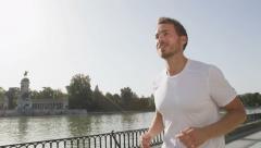 Running jogging man in city park El Retiro Madrid - SLOW MOTION Stock Footage