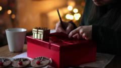 Happy woman in the room writing a christmas cards, close up HD Stock Footage