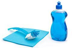 Blue dishwashing utensils Stock Photos