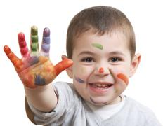 Little boy with paints Stock Photos