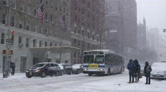 Snowing MTA public bus snowstorm blizzard 4k slow motion NYC Manhattan Stock Footage