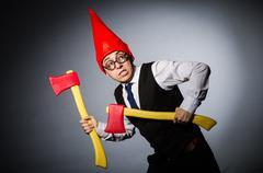 Man with axes in funny concept Stock Photos