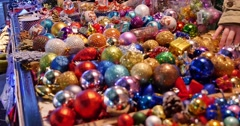 Close up shot of colorful Christmas balls on a table at a Christmas market - stock footage