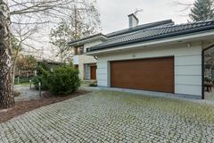 Stock Photo of Modern detached house with garage