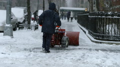 Industrial snowplow blizzard man plowing snow slow motion 4k NYC Manhattan Stock Footage