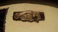 Stock Video Footage of old wrought metal product Fish on the wall of the ancient forge
