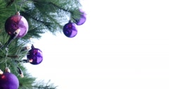 Footage of a christmas tree with purple and white balls on it Stock Footage