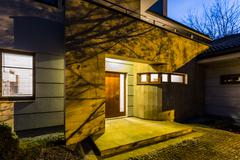 External view detached house at night Stock Photos