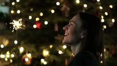 Cheerful woman with bengal lights on Christmas eve, slow motion HD Stock Footage