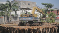 Tractor building wooden bridge Stock Footage