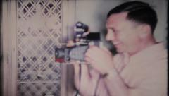1693 - taking photos with classic Polaroid Camera - vintage film home movie - stock footage