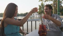 Couple drinking sangria in cafe outdoors in Madrid Spain Stock Footage