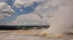 Clepsydra Geyser spewing hot water and steam in Yellowstone National Park - stock footage