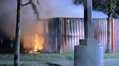 fenced  dumpster area fire burning the fence - stock footage