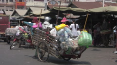Lady Walking With Recycling Cart In Busy Asian City [ProRes] Stock Footage