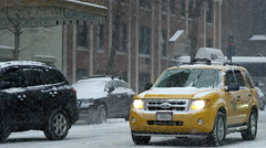 Taxi driving snowing 4k slow motion cab blizzard snow storm Manhattan NYC Stock Footage