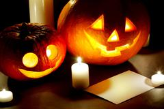 Halloween pumkins, candles and postcard - stock photo