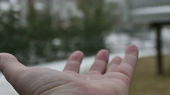 2924 Snowflakes Falling in Mans Hand in Slow Motion Stock Footage