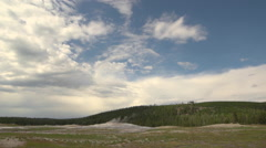 A wide shot of the Old Faithful geyser spewing steam Stock Footage