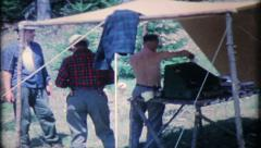 1690 - men camping in the woods - vintage film home movie Stock Footage