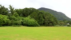 Green lawn in front of Muckross Lake Stock Footage