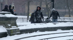 Racially diverse Washington Square Park blizzard snowing slow motion 4k NYC Stock Footage