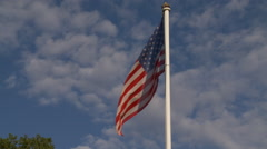 American Flag waving over blue sky - stock footage