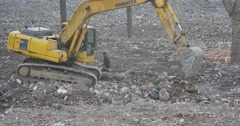 4k excavator working & dumper truck on construction site,china. Stock Footage