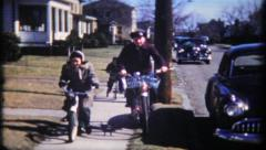 1700 - family on a neighborhood bicycle ride - vintage film home movie Stock Footage