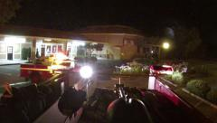 First responders view fire truck responding arriving on scene lights flashing Stock Footage