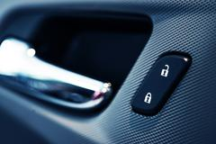 Car Door Lock Button Closeup. Electric Locking Button in Modern Car. Stock Photos