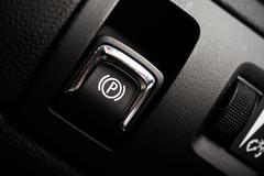 Electronic Brake Button. Modern Car Feature. Brake Button Closeup - stock photo