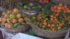 Fruit Stall in Asian Market Upwards Pan [ProRes] - stock footage