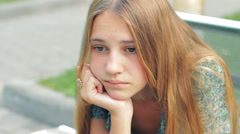 Sad Depressed Young Teenager Girl Sitting Alone In City HD Stock Footage