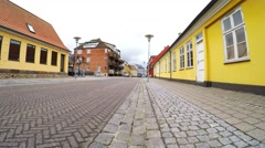 Walking on cobblestones in the older part of town - stock footage