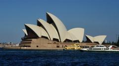 Australia Sydney ferries pass the Opera House 4k Stock Footage