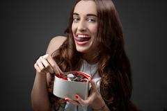 Woman with sweets. Happy Valentine concept - stock photo
