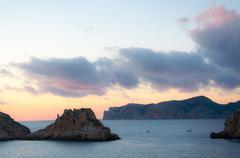 Winter sunset at Es Malgrat islands Mallorca in February. - stock photo