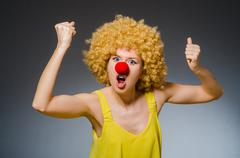 Funny woman in clown dressing - stock photo