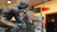 Sculpture of The Thinker in Souvenir Shop Stock Footage