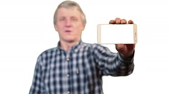 Mature man showing  cellphone with white screen, dialing number and calling Stock Footage