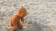 Playing sand by the happy bear marionette Stock Footage
