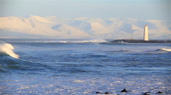 Heavy waves rolling into Grotta bay, Reykjavik Iceland winter sunny day Stock Footage