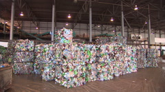 Sort the plastic debris in the factory for waste disposal. - stock footage