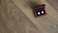 Cufflinks at wooden background Stock Footage