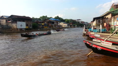 Nyaung Shwe, longboats in canal Stock Footage