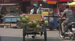 Man with Coconut Cart in Asian City [ProRes] Stock Footage